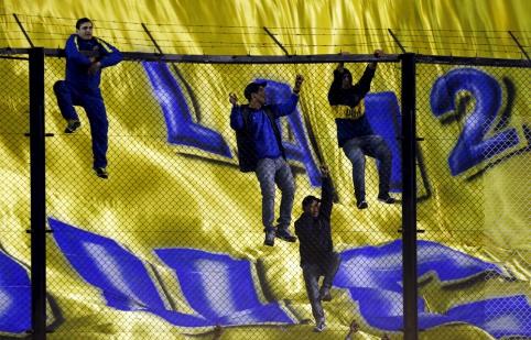 """40 tūkst. """"Boca"""" fanų kaip mesiją sutiko C.Tevezą (FOTO, VIDEO)"""
